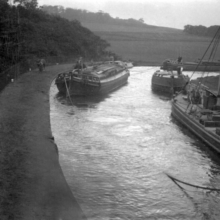 Barges on a bend of the Bridgewater Canal. Peel Archives Ref: PHO/BWC/2/1/3.